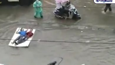 Photo of Two young men are floating on the raft in the frozen water of the road! Extremely viral video