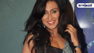 Photo of Rituparna, a Bengali bride in a hot bikini or red and white sari, is shaking her head in an appealing manner.